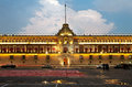 Illuminated national palace in zocalo of mexico city plaza de la constitucion at sunset and army square are among other local Royalty Free Stock Photography