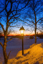 Illuminated old street lamp in winter landscape Royalty Free Stock Photo