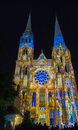 The illuminated Our Lady of Chartres cathedra at night , France.