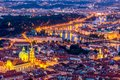 Illuminated Prague at twilight blue hour. VIew from Petrin hill Royalty Free Stock Photo