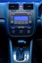 Illuminated radio and automatic shift gear column of modern executive car Stock Image