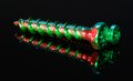 Illuminated screws red and green in black reflective back Stock Images