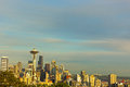 Illuminated Seattle skyscrapers and contour of Mount Rainier at sunset. Royalty Free Stock Photo