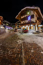 Illuminated street of madonna di campiglio at night italian alps italy Stock Photos