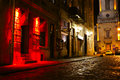 Illuminated street at night old european city Royalty Free Stock Photography