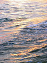 Illuminated waves water surface at sunset Royalty Free Stock Images
