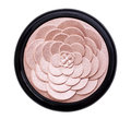 Illuminating face powder in the shape of a flower isolated on white background Stock Photos