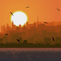 Illustration of big city ​​by the sea at sunset. Stock Image
