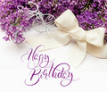 Illustration of bouquet from lilac lilies with text Happy Birthday. Calligraphy lettering Royalty Free Stock Photo