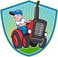 Farmer Driving Vintage Tractor Cartoon Royalty Free Stock Photo
