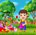 Gardener holding flower and watering can in a flower garden
