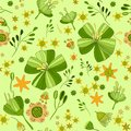 Illustration, green and orange with yellow flowers on a green background , seamless pattern Royalty Free Stock Photo