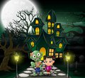 Happy halloween zombie cartoon in front of the haunted house with full moon background Royalty Free Stock Photo