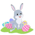 Illustration with the image of a rabbit and colored Easter eggs.