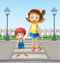 A little child and a girl crossing the pedestrian