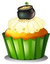 Illustration of a pot of gold at the top of a cupcake on a white background Royalty Free Stock Photo