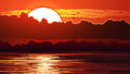 Illustration of red sunset and glare on water. Royalty Free Stock Photo