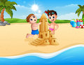 Two boy making sand castle at the beach Royalty Free Stock Photo