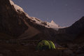 Iluminated camping tent on the base of alpamayo mountain in huaraz peru Royalty Free Stock Image