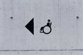 Image of an accessibility symbol on a wall peering stone Stock Image