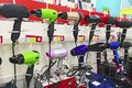 Image of assortment of different hair dryers at household appliances shop Royalty Free Stock Photo