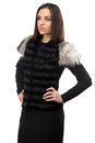 Image of attractive woman in black fur waistcoat on white background Stock Photo