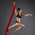 Image of beautiful dance performer on aerial silks studio photo Royalty Free Stock Images
