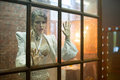 Image of the beautiful woman behind the glass on brick wall background Stock Images