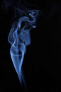 Image beautiful woman made fume against dark background Stock Photo