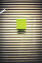 Image of blank sticky note on office glass wall with jalousie Royalty Free Stock Photo