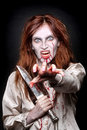 Image of a bleeding psychotic woman scary horror with knife Royalty Free Stock Images