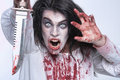 Image of a bleeding psychotic woman scary horror with knife Stock Photo
