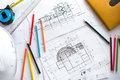 Image of blueprints with level pencil and hard hat on table Royalty Free Stock Photo