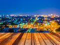 Image of blurred bokeh background with colorful lights blurred wood table and Royalty Free Stock Photos