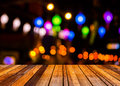 Image of blurred bokeh background with colorful lights blurred wood table and Royalty Free Stock Photography