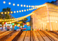 Image of blurred bokeh background with colorful lights blurred wood table and Stock Photos