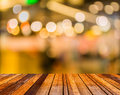 Image of blurred bokeh background with colorful lights blurred wood table and Stock Photography