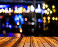 Image of blurred bokeh background with colorful lights blurred wood table and Stock Images