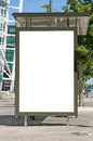 An image of a bus stop with a blank bilboard for your advertising situated in front of the turning torso skyscraper in the swedish Stock Images
