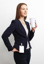 Image of business woman holding coffee cup over white background Stock Images