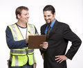 Image of a businessman and construction worker discussing report Stock Photography