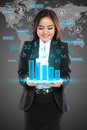 Image of businesswoman in black suit showing graph over world background Royalty Free Stock Photos