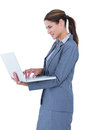 Image of confident businesswoman holding laptop on white background Royalty Free Stock Image