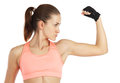 Image de la jeune femme sportive montrant son biceps d isolement sur le blanc Images stock