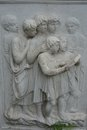 Image of fascinated reading children in stone stone carving medieval Stock Photography