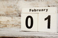 Image of February First wooden vintage calendar on white background Royalty Free Stock Photo