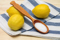 Image of fresh lemons and citric acid in spoon studio photo Royalty Free Stock Image
