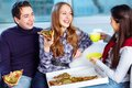 Image of happy teenage friends eating pizza together Stock Photography