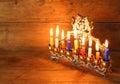 Image of jewish holiday hanukkah background with menorah traditional candelabra and burning candles Royalty Free Stock Photos