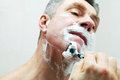 Image of man shaving Stock Photography